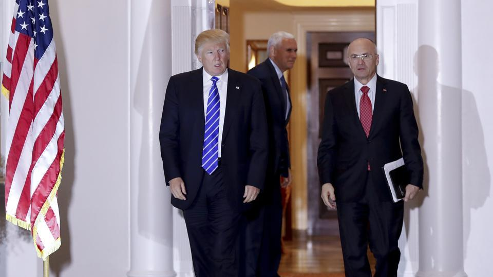 President-elect Donald Trump walks with Andy Puzder at Trump National Golf Club in Bedminster, New Jersey, on November 19.