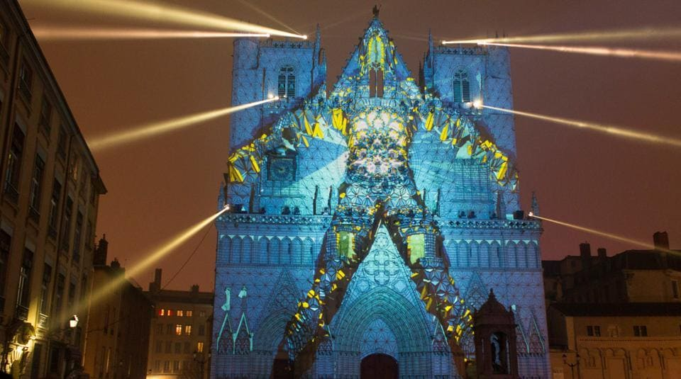 An installation called View of Evolutions by artist Yann Nguema is seen on the Saint-Jean Cathedral during the rehearsal for the Festival of Lights (Fetes des Lumieres) in Central Lyon, France on December 7, 2016.  (REUTERS)