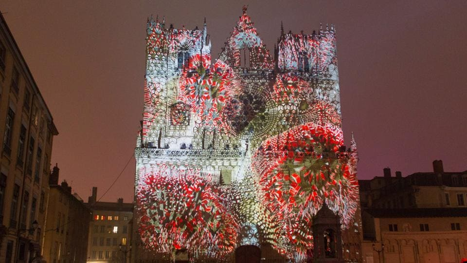 An installation by Yann Nguema at the Saint-Jean Cathedral on December 7, 2016. The festival is celebrated each year since December 8, 1852 on the feast of Immaculate Conception, a tribute to Mary, mother of Jesus, after the town was spared by the 1643 plague.  (REUTERS)