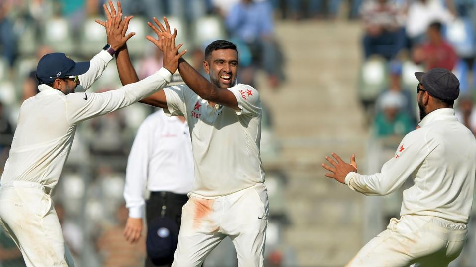 India's Ravichandran Ashwin (centre) celebrates with teammates after scalping an England wicket at the Wankhede stadium in Mumbai on Friday. Ashwin took 6 wicket in England's first innings, while Ravindra Jadeja took four.