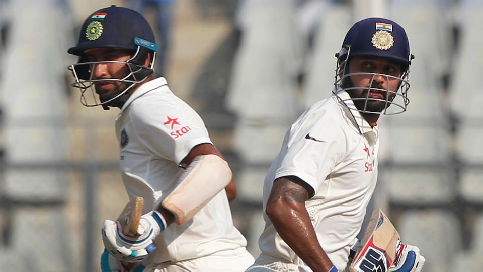 Murali Vijay and Cheteshwar Pujara shared a 100-run partnership to boost India on the second day of the Wankhede Test versus England.