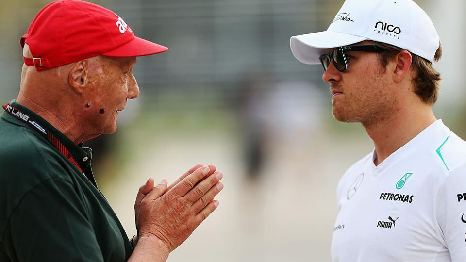 Lauda talks and Nico Rosberg of Mercedes F1 team in the paddock during the Bahrain Formula One Grand Prix.
