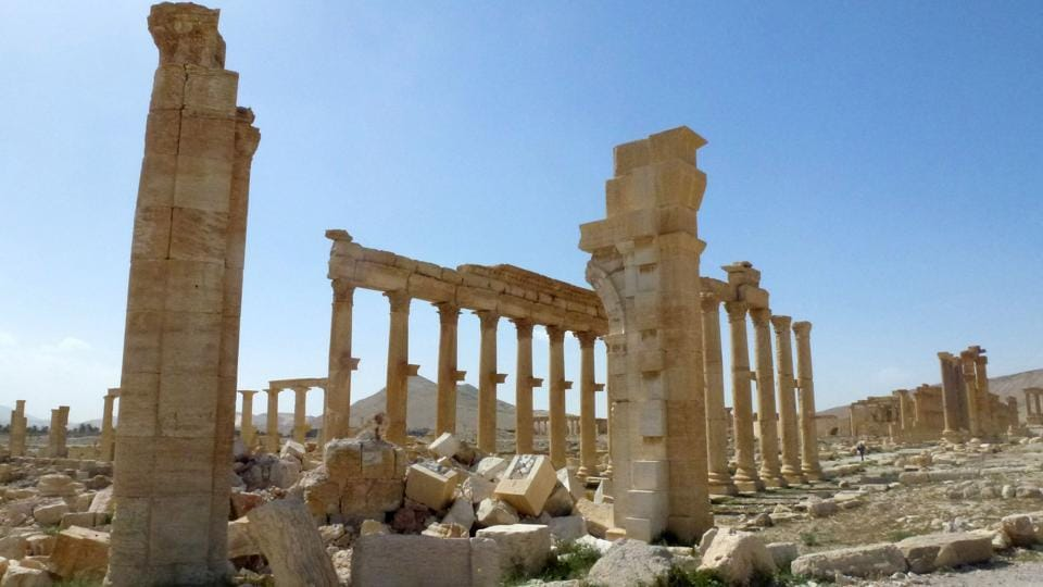 This file photo taken on March 27, 2016 shows a view of the remains of Arch of Triumph, also called the Monumental Arch of Palmyra, that was destroyed by Islamic State group jihadists in October 2015 in the ancient Syrian city of Palmyra.