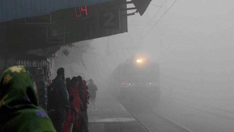 A train arrives at Faridabad Railway Station amid dense fog on Thursday. Many trains are running late or being cancelled owing to fog.