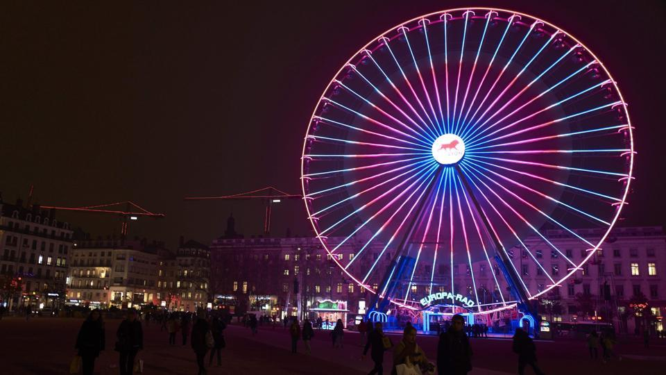 The ferris wheel on Place Bellecour in downtown Lyon illuminated on December 7, 2016.  (AFP)