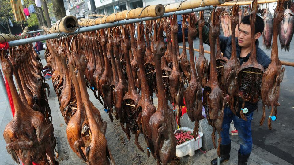 A vendor arranges salted dried ducks at Hangzhou in China's Zhejiang province.