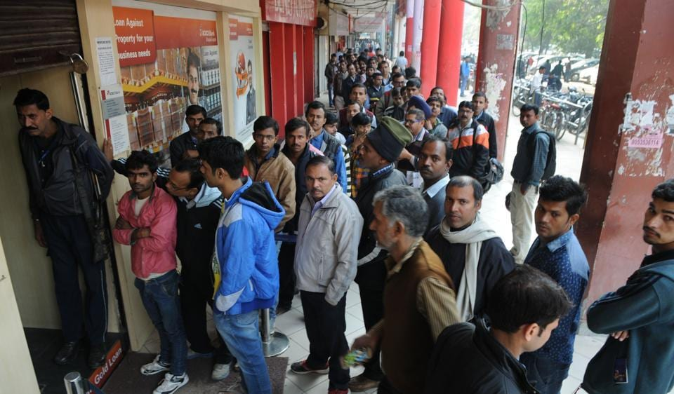 People queue up outside ICICI Bank in Sector 14. Though the government has been pushing for a cashless economy, many people have their concerns on going digital.