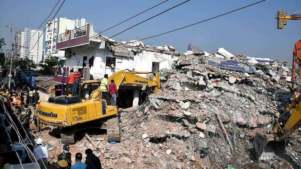 Rescue workers dig through the rubble of a collapsed building in Hyderabad on December 9, 2016.