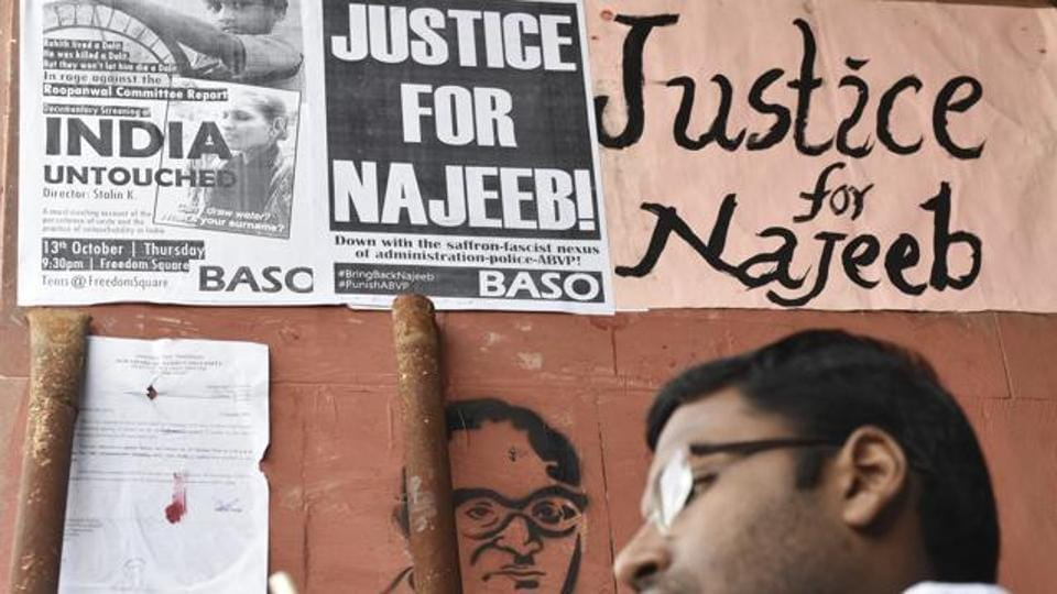 Students sit outside the JNU administrative block while protesting against the disappearance of NajeebAhmed.