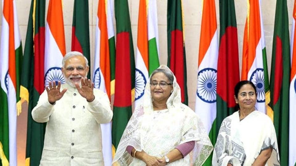 Prime Minister Narendra Modi gestures as Bangladesh's Prime Minister Sheikh Hasina and West Bengal chief minister Mamata Banerjee look on during the Indian PM s visit to Bangladesh