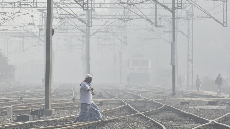 Trains delayed due to heavy dense fog at New Delhi Railway station in New Delhi on Thursday.