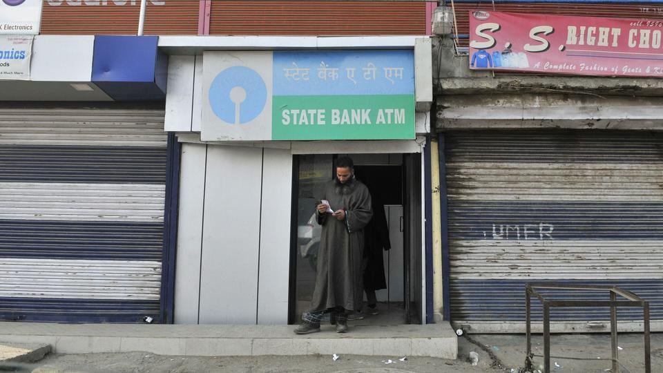 A man emerges from an ATM in Sopore in north Kashmir after withdrawing money.  After demonetisation,  queues outside banks and ATMs in Kashmir have been without rush unlike that in other parts of the country.