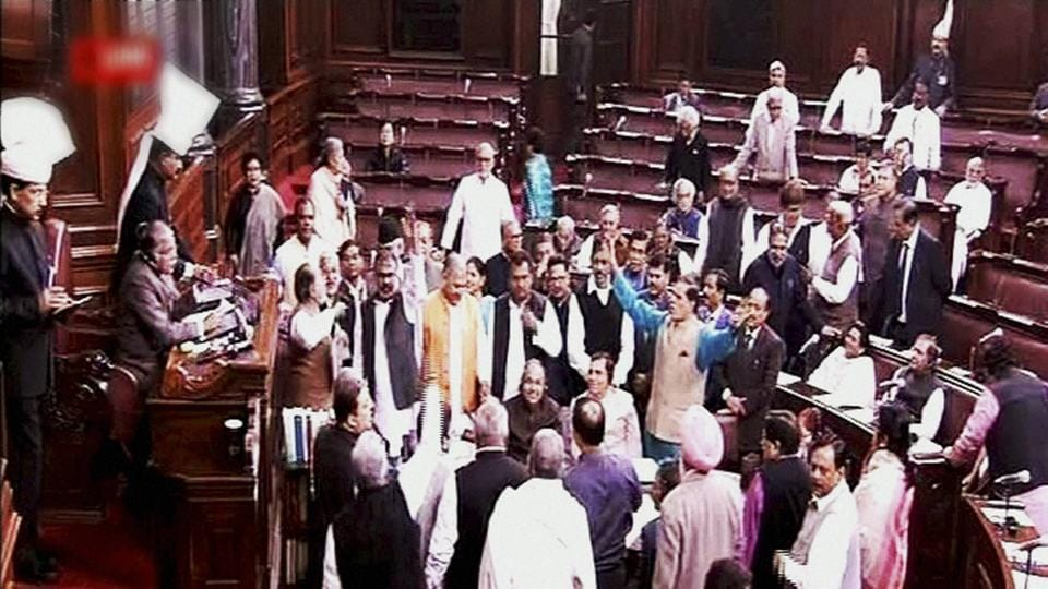 Members protest in the Rajya Sabha during the winter session of Parliament in New Delhi on Friday.