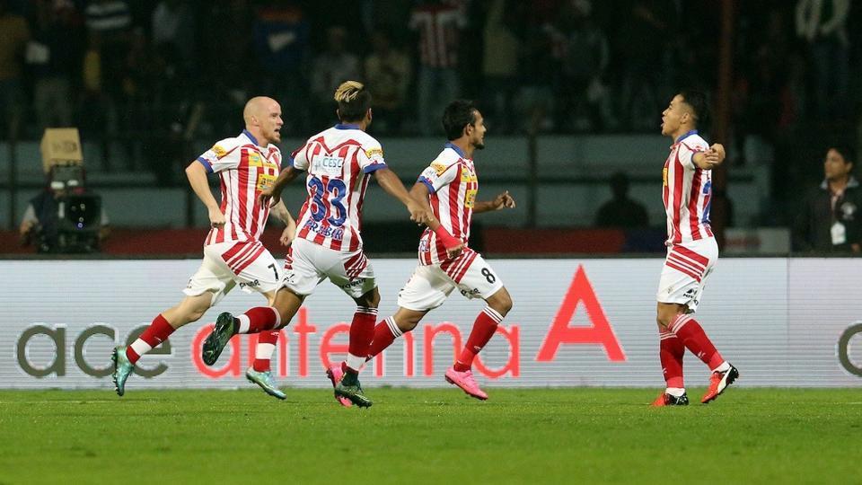 Atletico de Kolkata players celebrate after scoring against Mumbai City FCin ISLsemifinals.