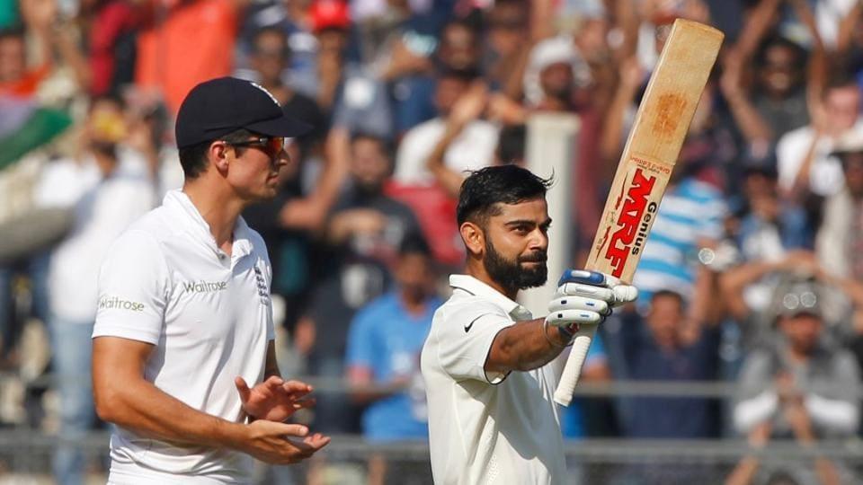 Virat Kohli celebrates his century against England in Mumbai.