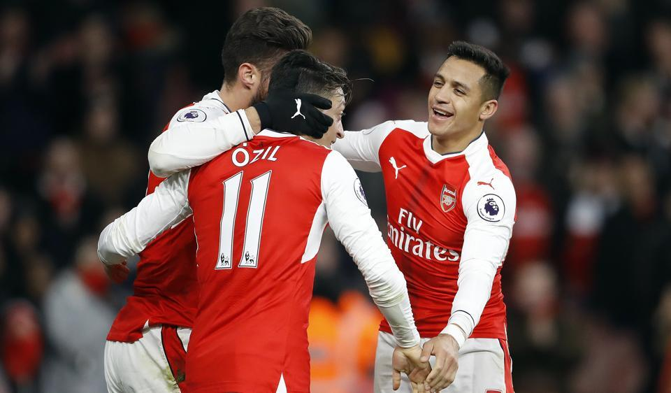 Arsenal's Olivier Giroud, from left, Arsenal's Mesut Ozil and Arsenal's Alexis Sanchez celebrate after scoring during the English Premier League match.