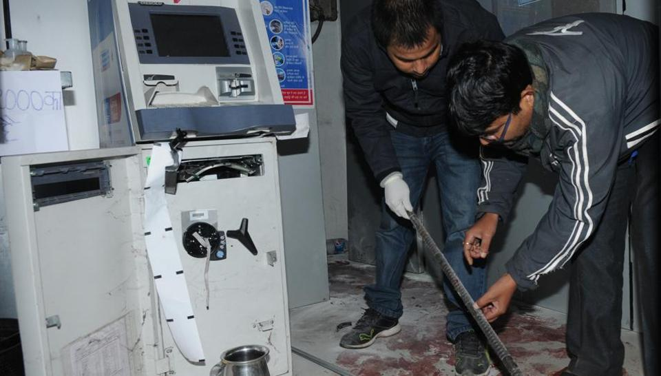 Investigators at the Central Bank ATM where the guard was murdered.