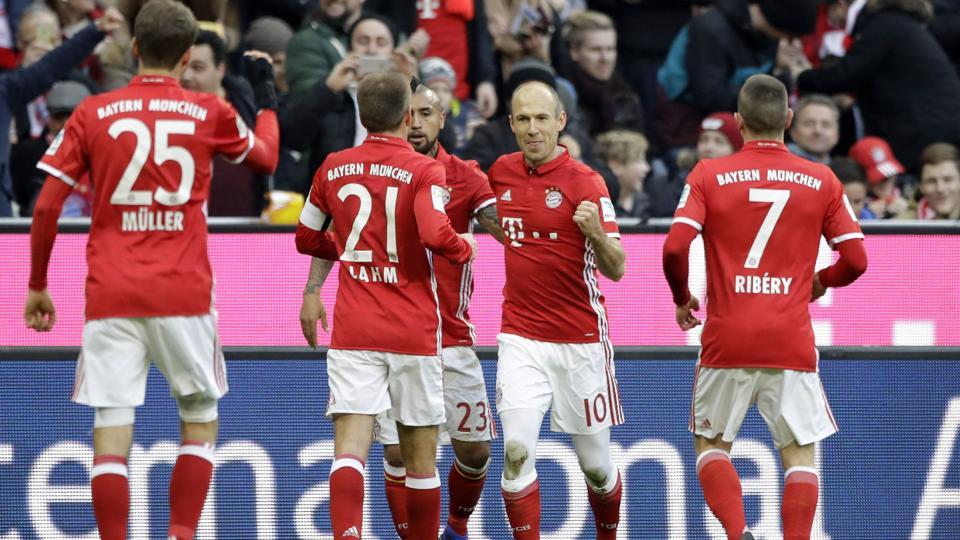Bayern's Arjen Robben, second right, celebrates after scoring his side's first goal during the German Bundesliga match between FC Bayern Munich and VfL Wolfsburg.