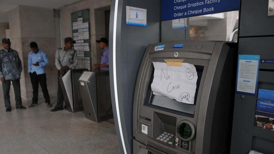 A hand-written sign indicates the status  of an ATM in Gurgaon