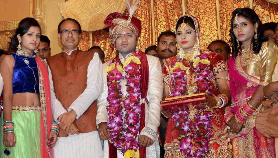 Madhya Pradesh CM Shivraj Singh Chouhan at the wedding ceremony of the daughter of the head warder of Central Jail Ramashankar Yadav, who was killed by SIMI operatives during their escape, in Bhopal on Friday.