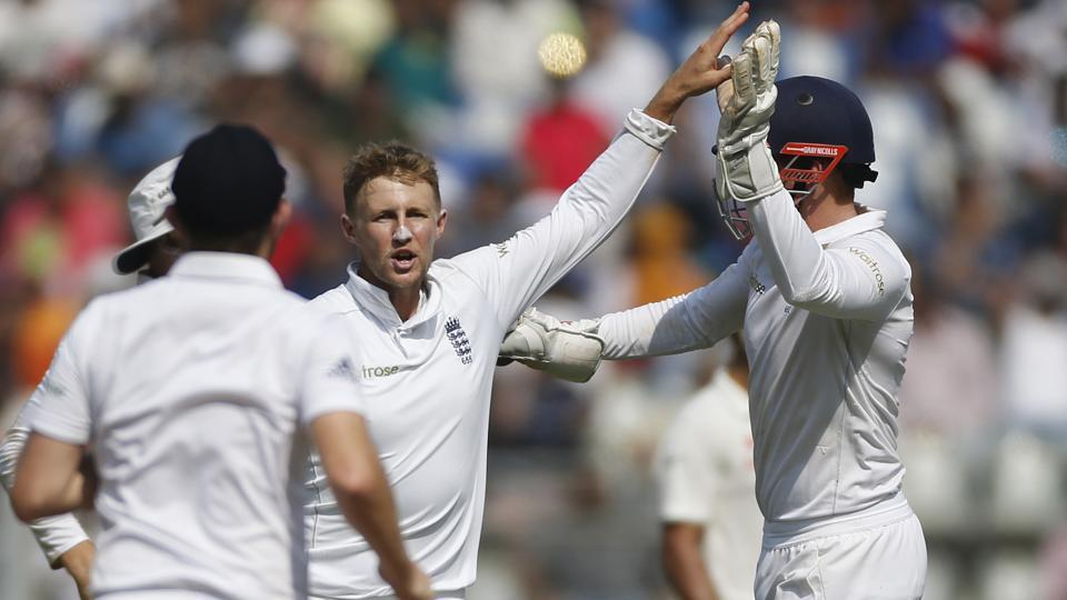 England's Joe Root (centre) took two Indian wickets with his part-time spin bowling -- scalping Parthiv Patel and Ravichandran Ashwin at the Wankhede Stadium.