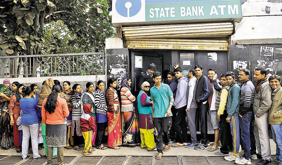 Residents are braving the cold weather and fog to wait in ATM queues.