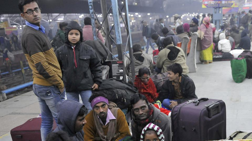 People waiting for their train at the Ludhiana railway station on Friday.