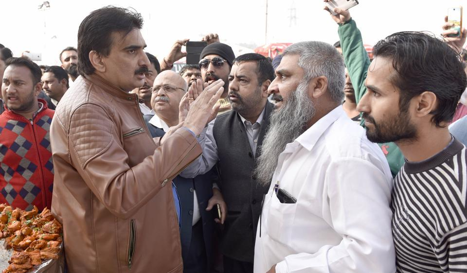Pak exhibitors and their representatives, and protesters (right) led by self-styled Hindu leaders arguing at PITEX in Amritsar on Saturday, December 10.