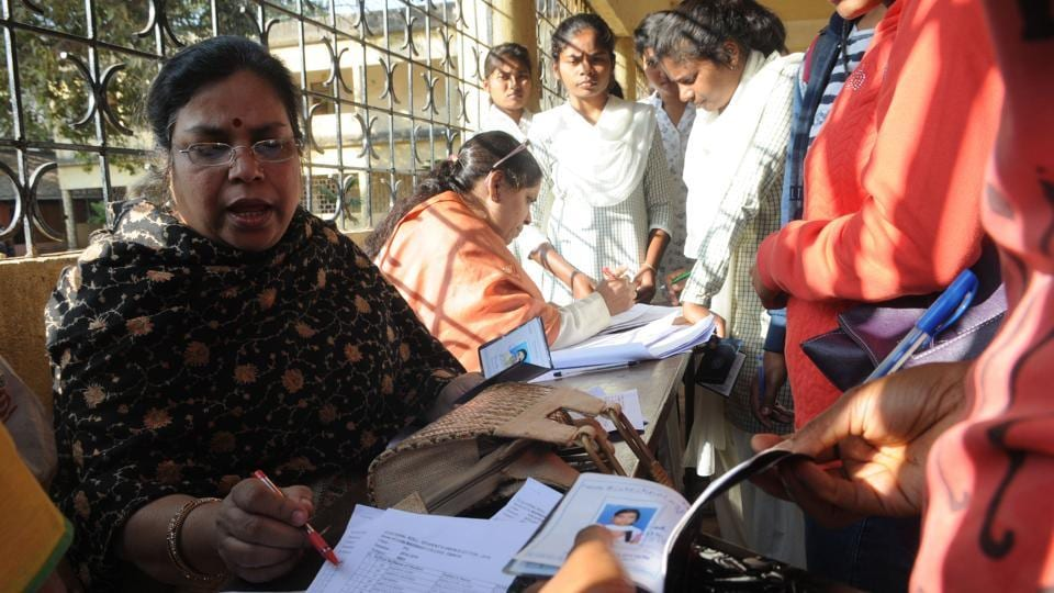Polling officials verifying identity of students during Ranchi University students' union elections on Friday.