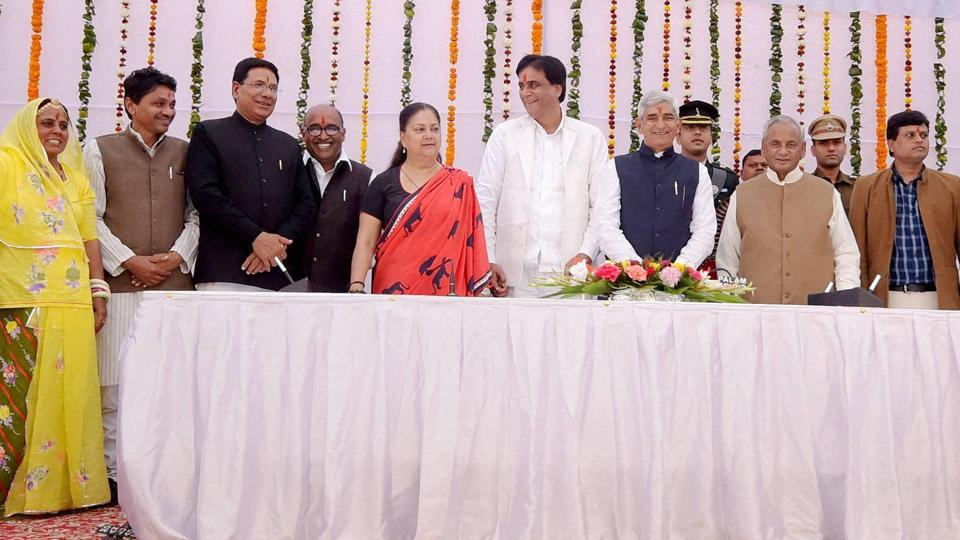 Newly inducted ministers pose for a group photo with governor Kalyan Singh and chief minister Vasundhara Raje after the swearing-in ceremony at Raj Bhavan in Jaipur on Saturday.