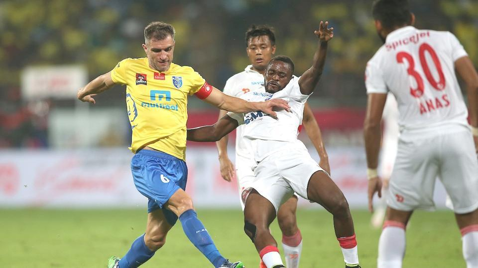 Kerala Blasters and Delhi Dynamos players vie for the ball in their Indian Super League semfinal match.