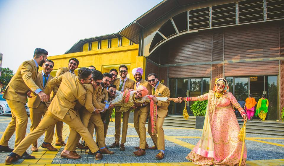 Matching outfits for the bridesmaids and groomsmen are in trend. Here, the groomsmen make a stylish mark at Rinee and Preet's wedding wearing matching mustard suits.