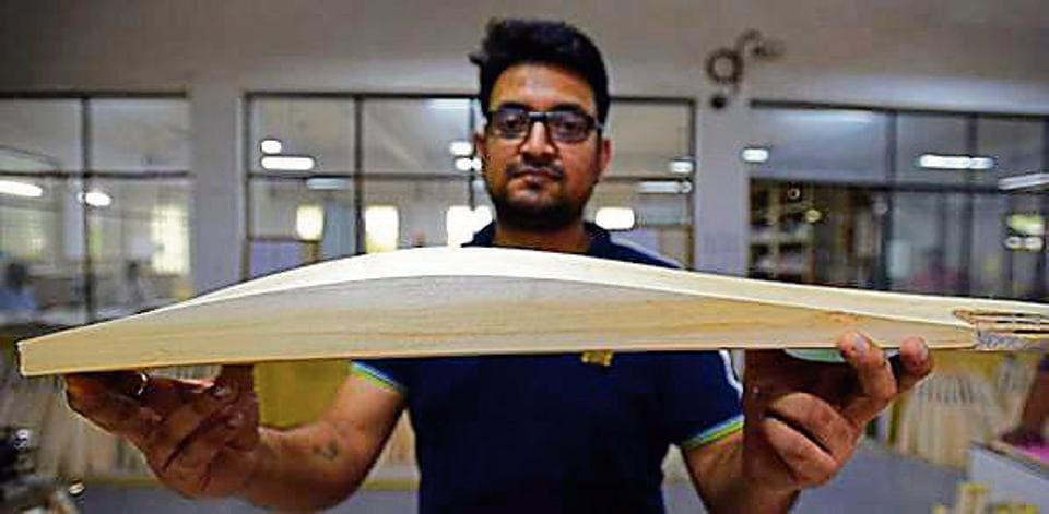 A'fat' cricket bat showing off its depth and long spine.