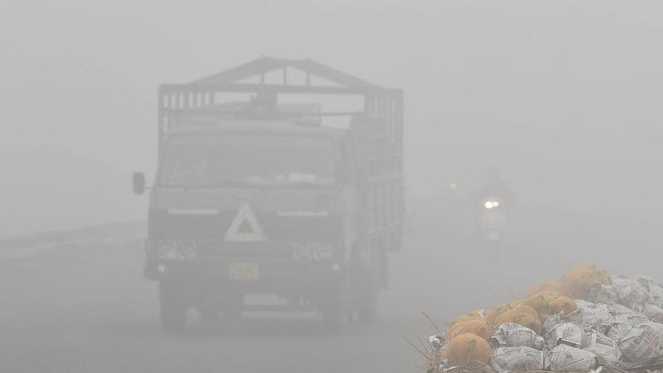 A truck makes its way through dense fog in Amritsar.