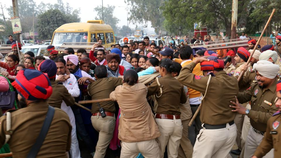 Bathinda,India-December 10,2016:Police resorting to lathicharge on EGS, AIE and STR on road in-front of police lines in Bathinda on Saturday who were marching towards Bathinda-Mansa railway over bridge to block the road.Photo by Sanjeev Kumar/Hindustan Times.