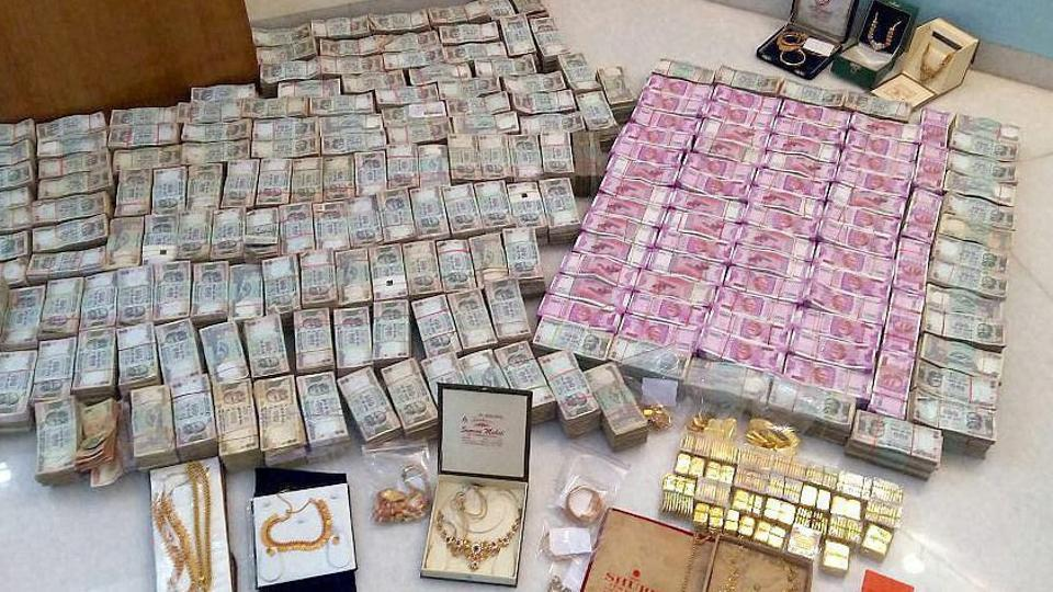 I-T department seized Rs 5.7 crore cash in new notes, 32kg bullion and jewellery and Rs 90 lakh old notes in Karnataka's Chitradurga district.