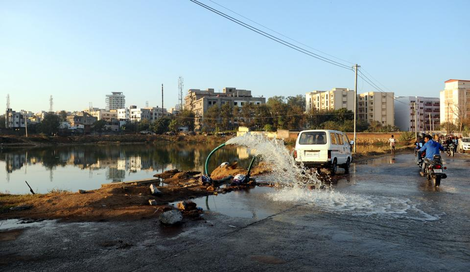 Water being pumped out from a pond near RIMS for the state government's beatification project in Ranchi.