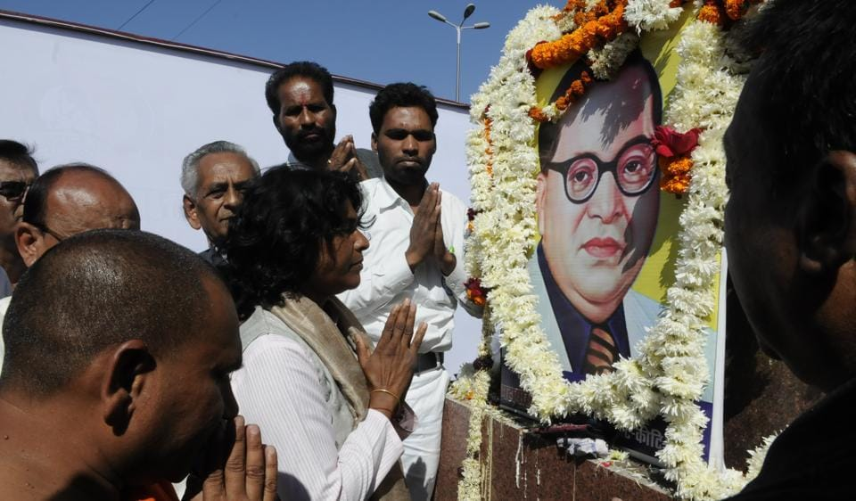 Suspended IAS officer Shashi Karnawat praying to BR Ambedkar at Board Office crossing in Bhopal on Saturday.