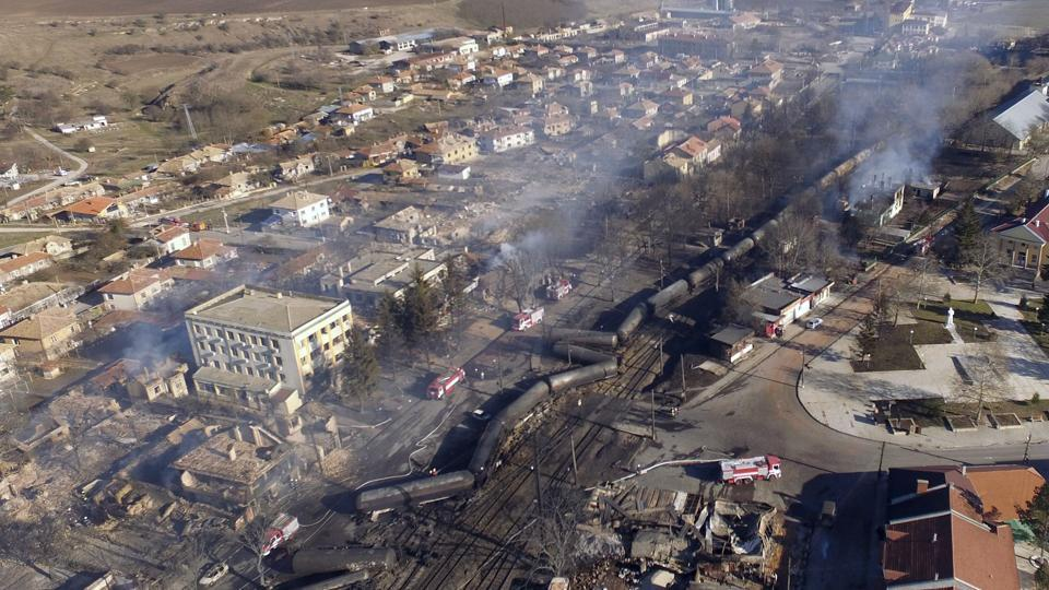 An aerial view shows the wreckage of a train transporting gas after it derailed and exploded in the northeastern Bulgarian village of Hitrino on December 10, 2016. At least seven people died and 27 were injured in the blast, emergency services said. Around 20 homes were smashed and many of the residents of the village of some 800 people were evacuated.