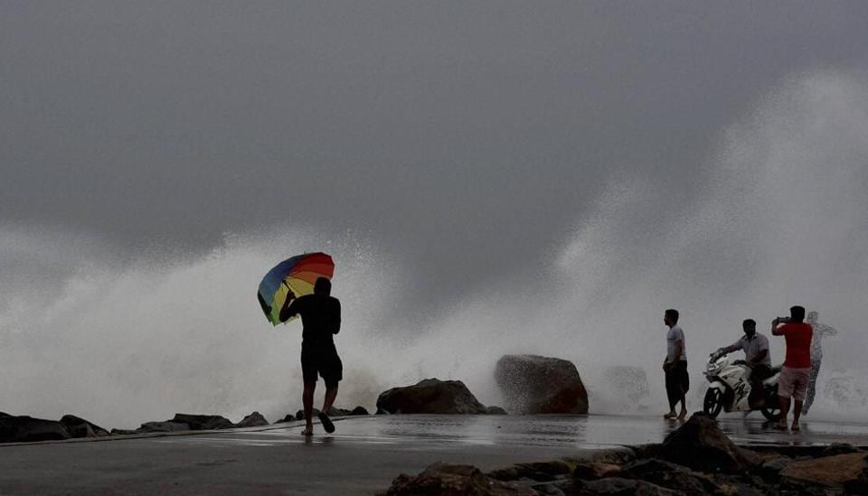 Waves rise high at the Ennore Beach in Chennai on Sunday, as Cyclone Vardah is likely to make landfall in the afternoon on Monday.