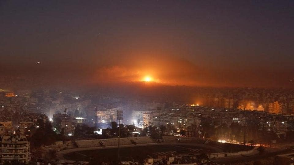 Smoke and flames rise after air strikes on rebel-controlled besieged area of Aleppo, as seen from a government-held side, in Syria.