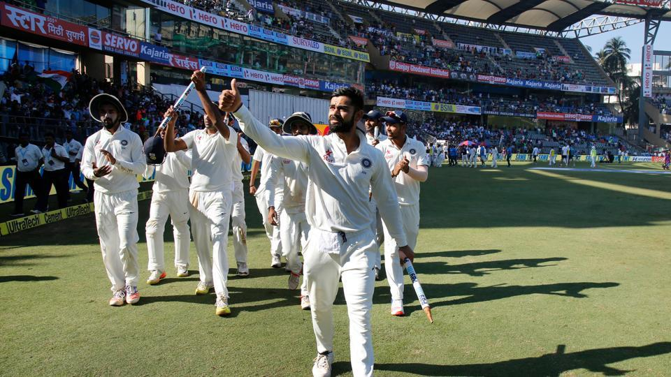 Virat Kohli and the whole Indian team took a lap of honour after winning the Wankhede Test against England. (Photo by: Deepak Malik/ BCCI/ SPORTZPICS)