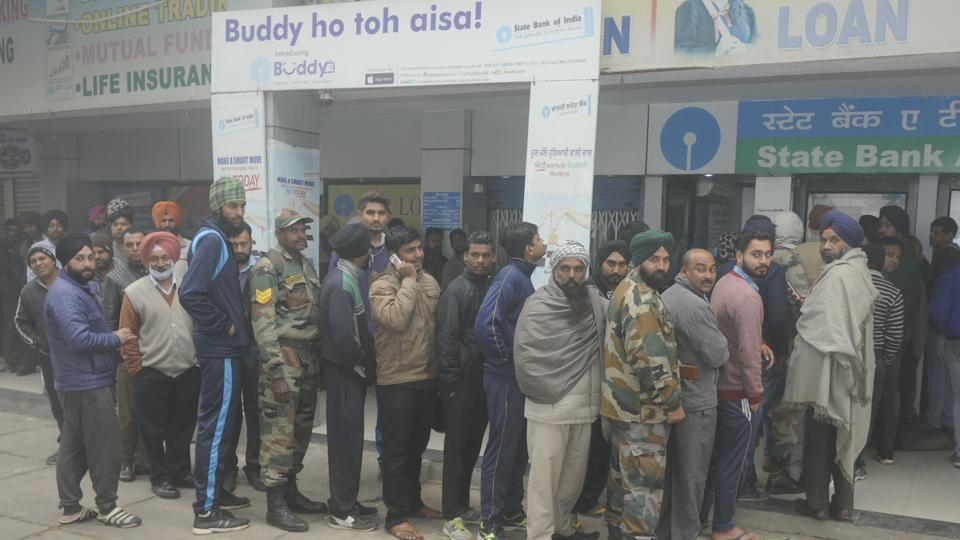 People in a queue outside an ATM in Patiala on December 8.