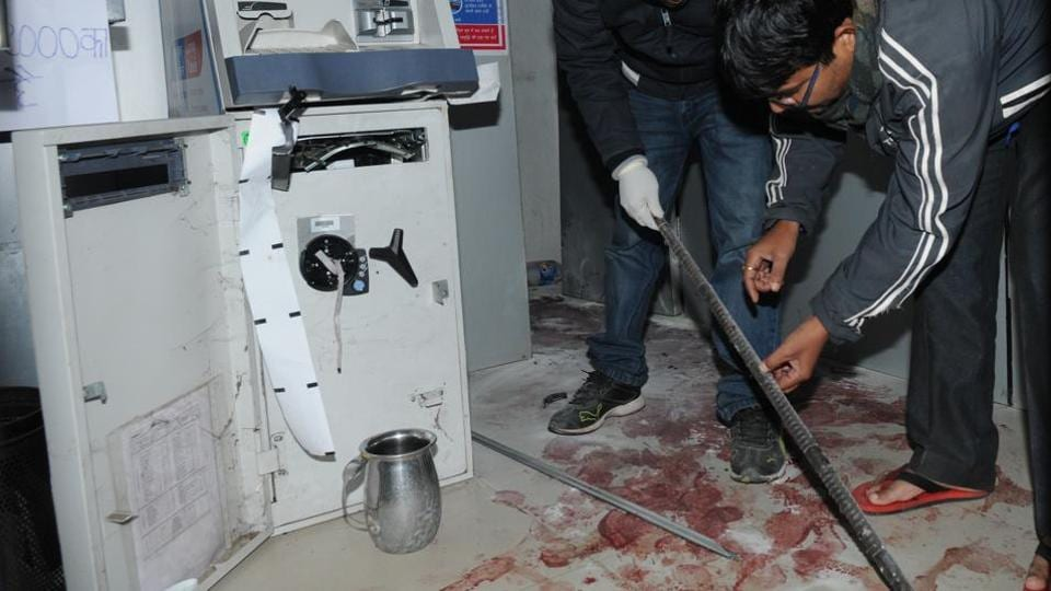 Experts investigate Central Bank ATM for attempted loot after a guard was murdered in the process in Patna on December 10.