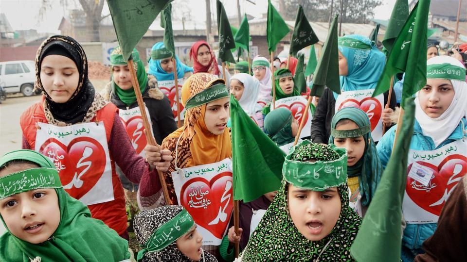 Girls holding Islamic flags and shouting religious slogans while taking part in an Eid-e-Milaad-un-Nabi in Srinagar. (PTI Photo)