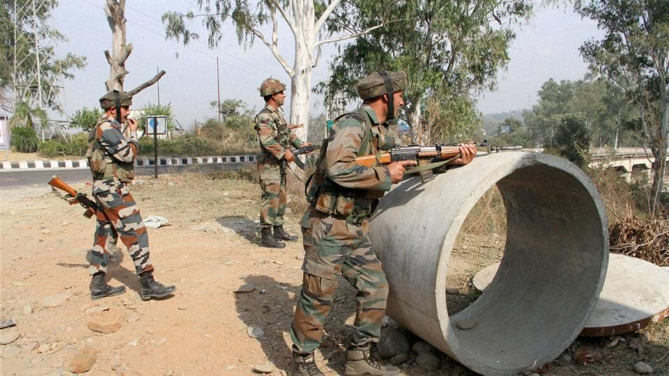 Jammu: Security personnel take positions during a gun battle with suspected militants at Army camp at Nagrota near Jammu.