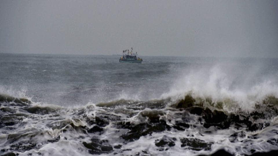 Fishermen return to harbour in Chennai on December 11.