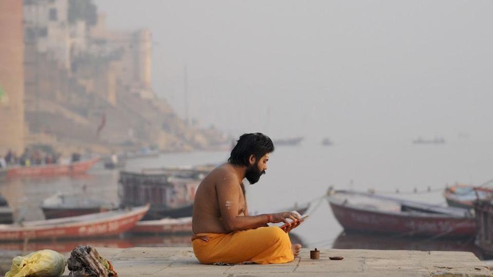 People offer early morning prayers and take holy dips at Ganga Mahal Ghat in Varanasi