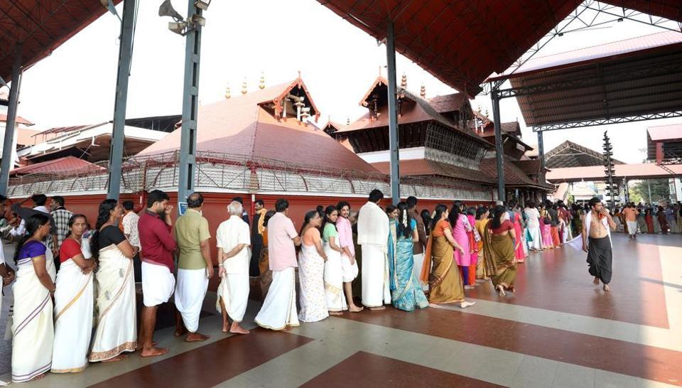 Devotees stand in queue outside Guruvayoor templein Thrissur ,Kerala.