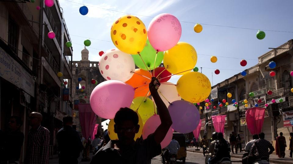 An Indian balloon seller sells balloons during a procession to celebrate Eid-e-Milad, in Hyderabad, India, Monday, Dec. 12, 2016.  (Mahesh Kumar A / AP Photo)